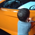 LOLmotor | Learn from a toddler how to open a McLaren .. #Video